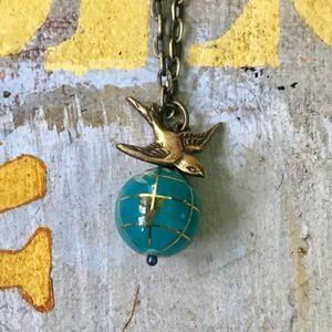 NWOT Anthropologie globe and brass bird necklace